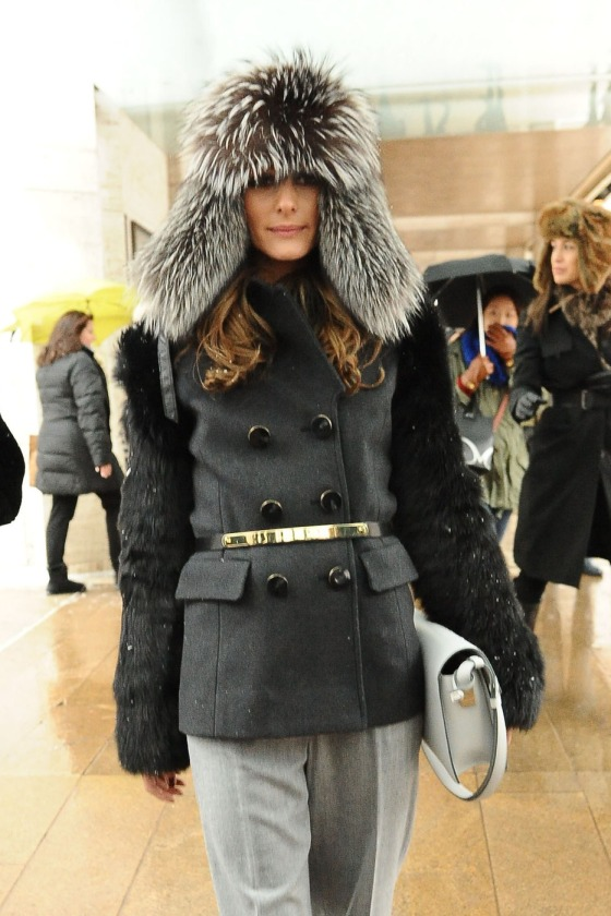 Olivia Palermo beats the bad winter weather with a fur lined hat and black jacket at a New York Fashion Week event