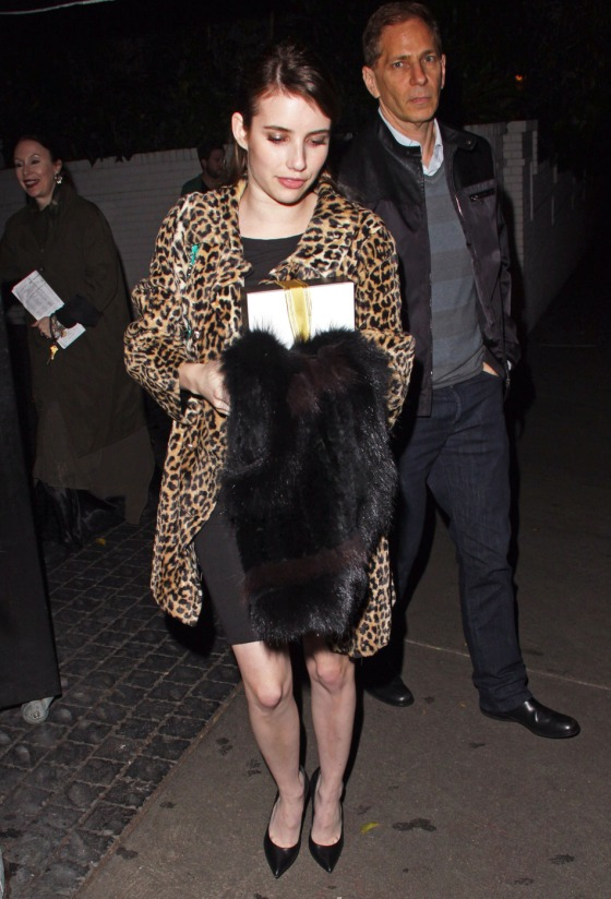 **EXCLUSIVE** Actress Emma Roberts seen wearing a animal print fur coat, black dress and a turquoise Chanel purse while leaving from the Chateau Marmont in Hollywood